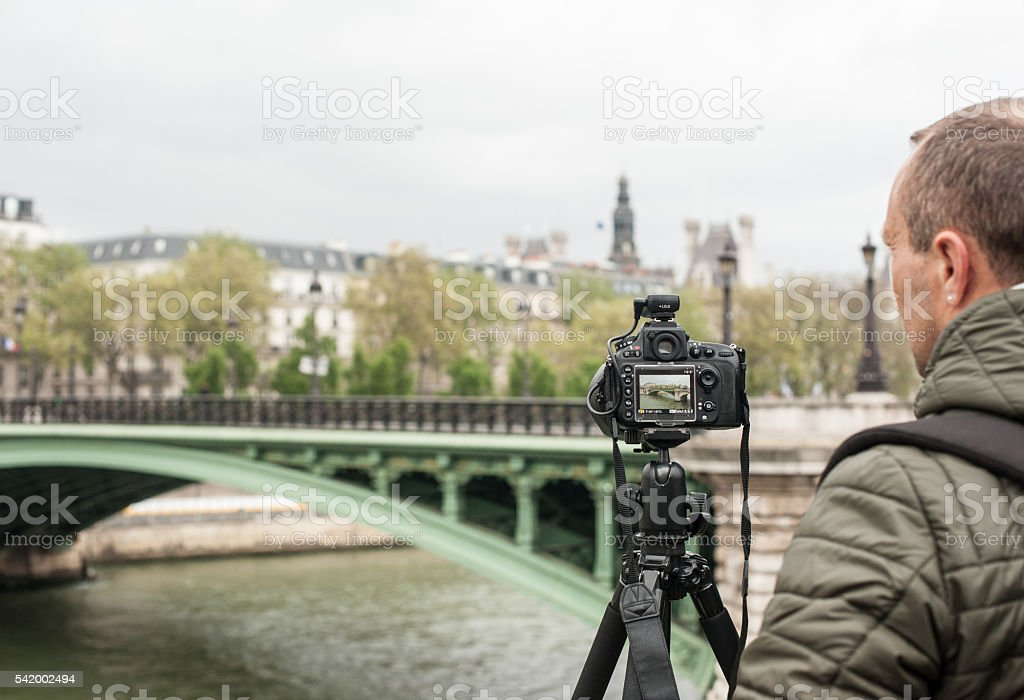 Male photographer in Paris, France stock photo