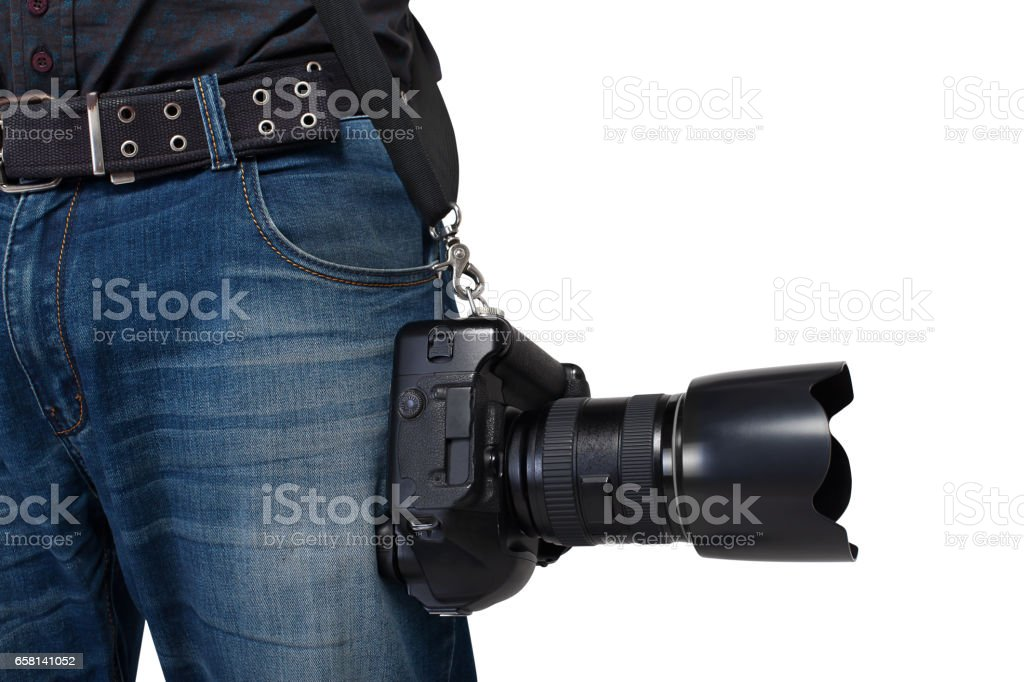 Male photographer legs with belt holding a camera stock photo