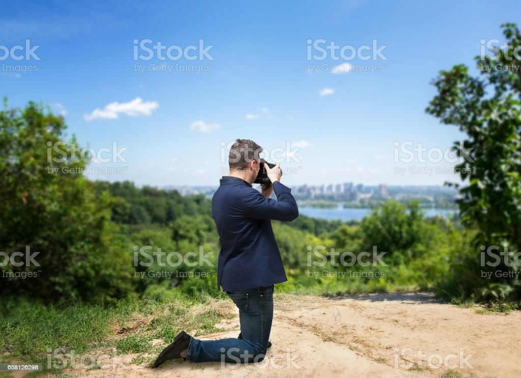 Male photographer taking picture of cityscape stock photo