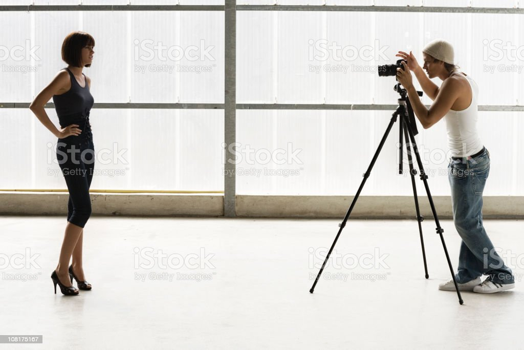 Male Photographer with Female Model During Shoot royalty-free stock photo