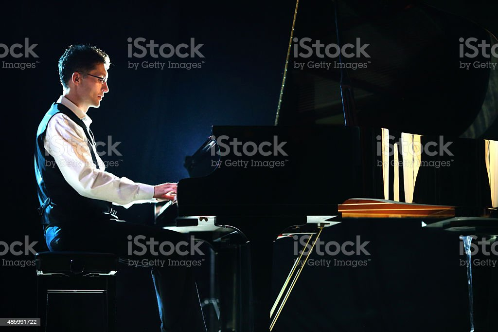 Male pianist in a concert. stock photo