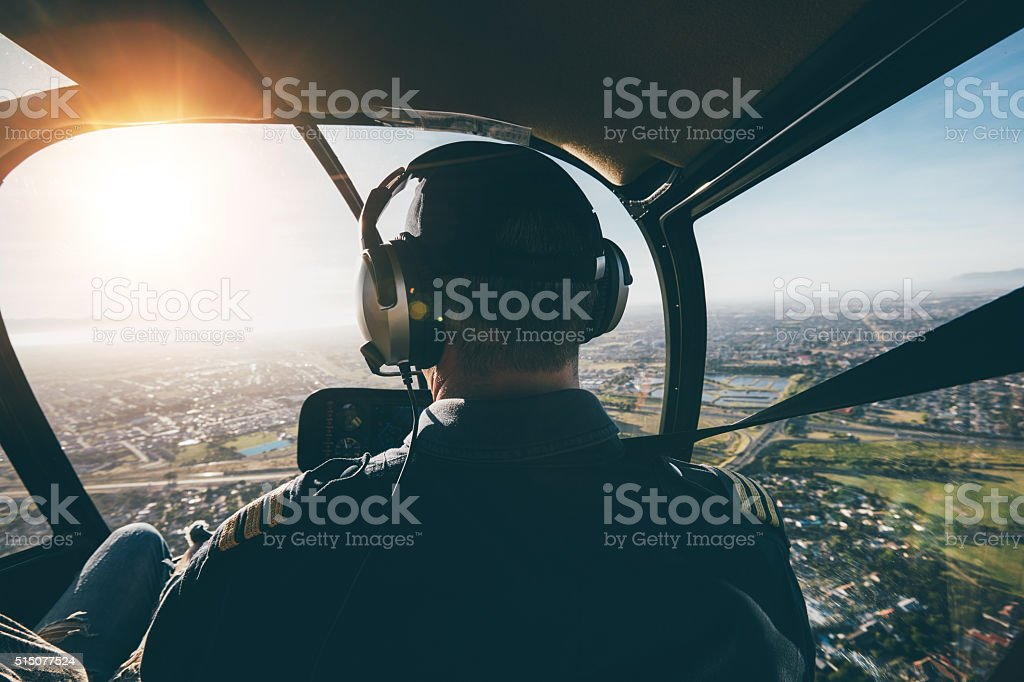 Male pilot flying a helicopter stock photo