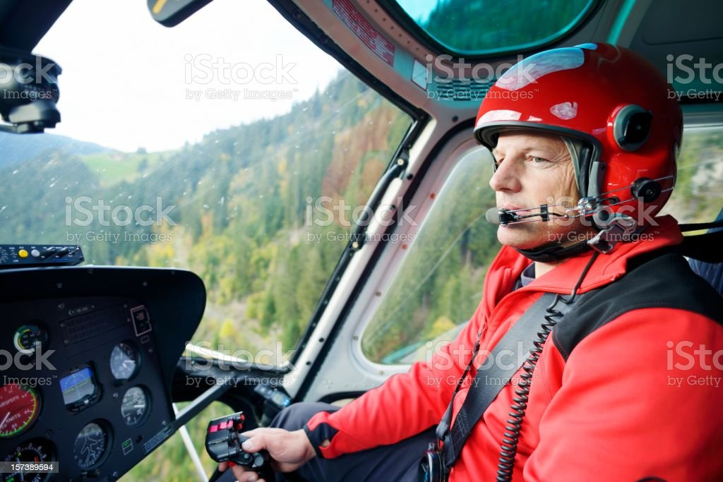 Male Pilot Flying Helicopter stock photo