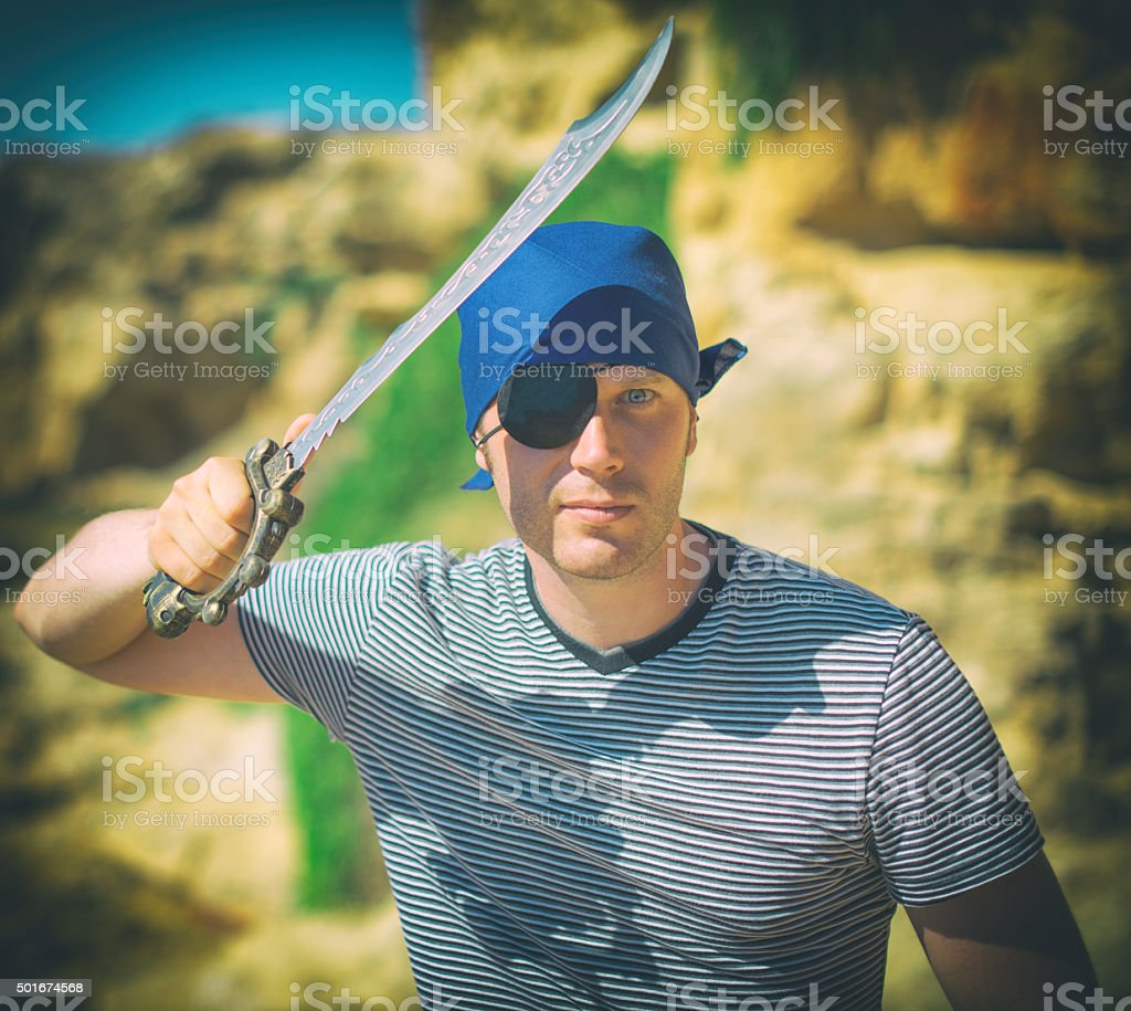 Male pirate with sword. Place for your text. stock photo