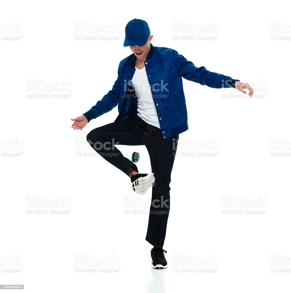 Male playing hacky sack stock photo