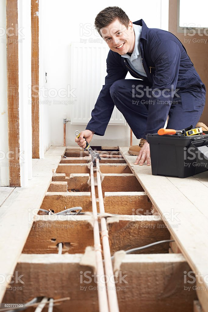 Male Plumber Fitting Central Heating System stock photo