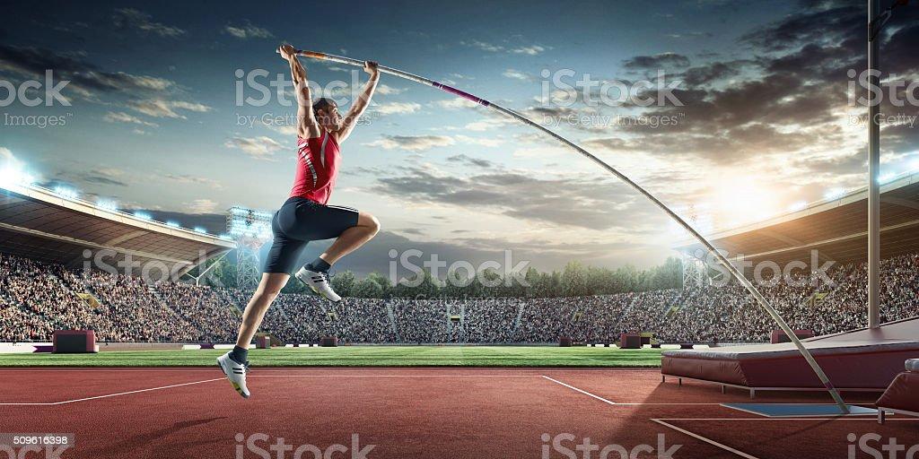Male pole vaulting athlete stock photo