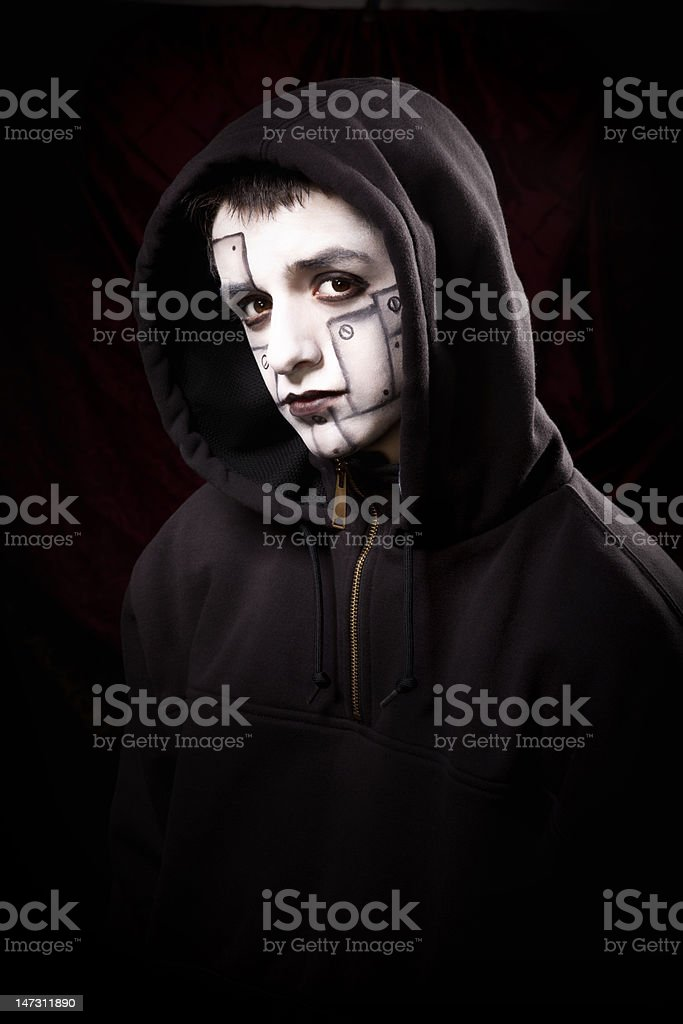 Male posing for a studio shot, wearing face paint. royalty-free stock photo