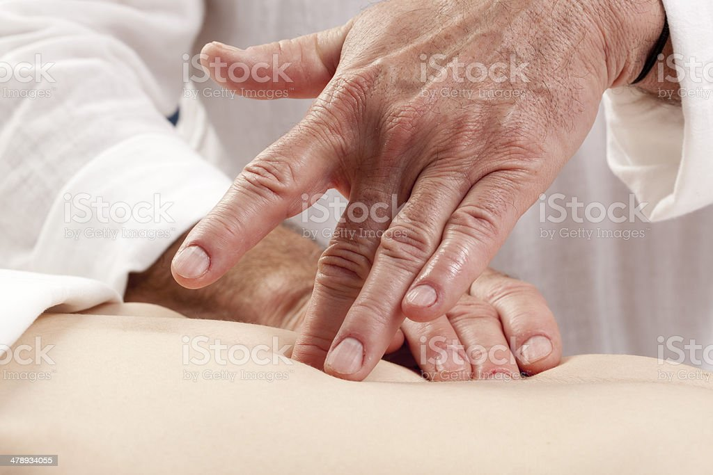 male practitioner relaxing stomach pain royalty-free stock photo