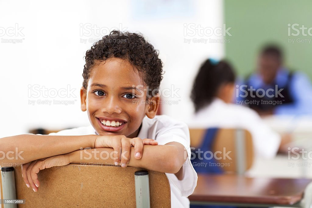 male primary school student in classroom stock photo