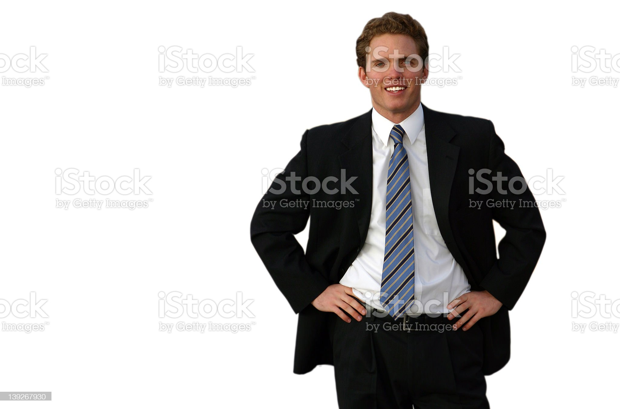 Male professional in a black suit with a blue, striped tie royalty-free stock photo