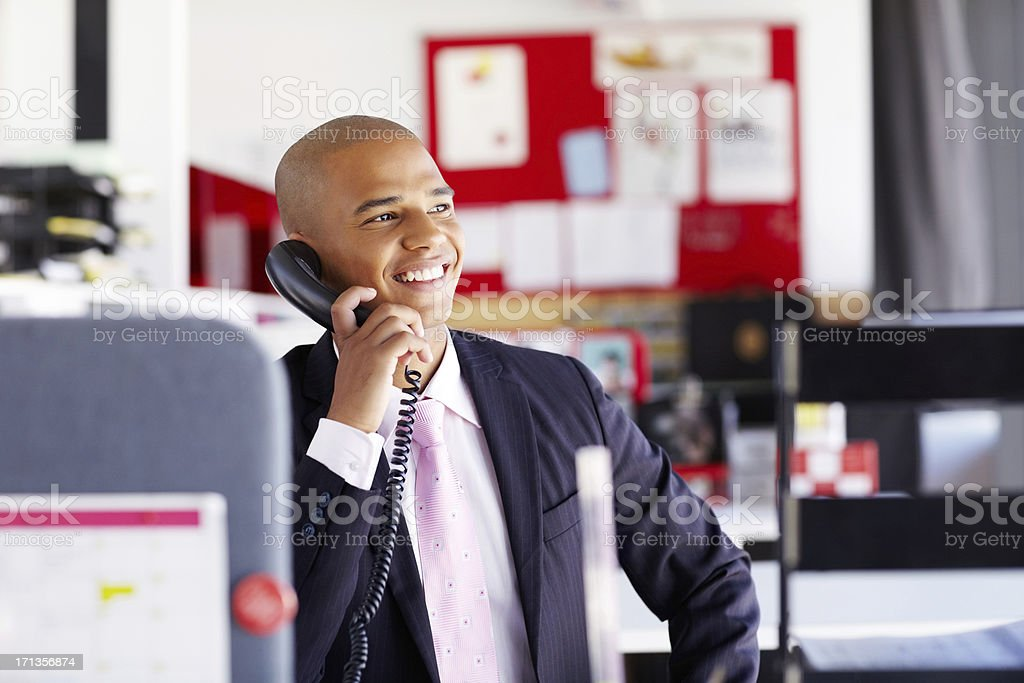 Male Professional On The Phone In Office stock photo