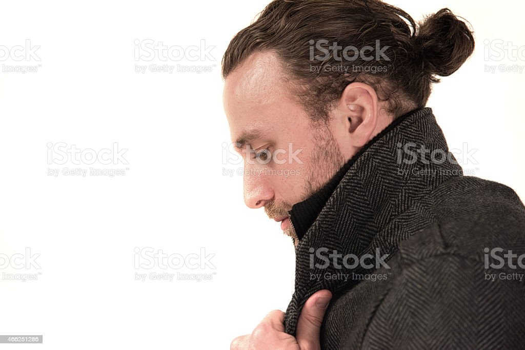 Male Profile Looking down while holding collar stock photo