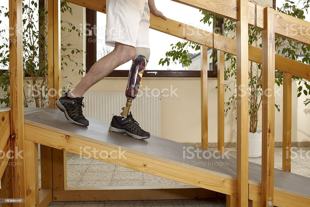 Male prosthesis wearer training on slopes stock photo