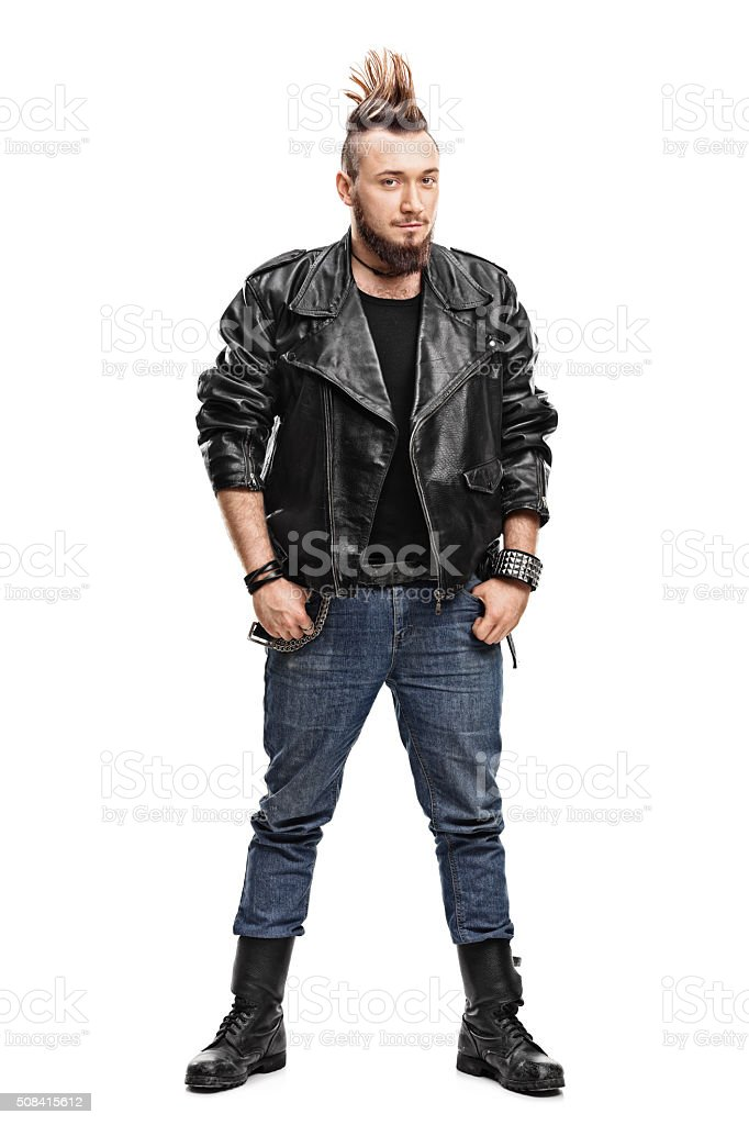 Male punk in a leather jacket and boots stock photo