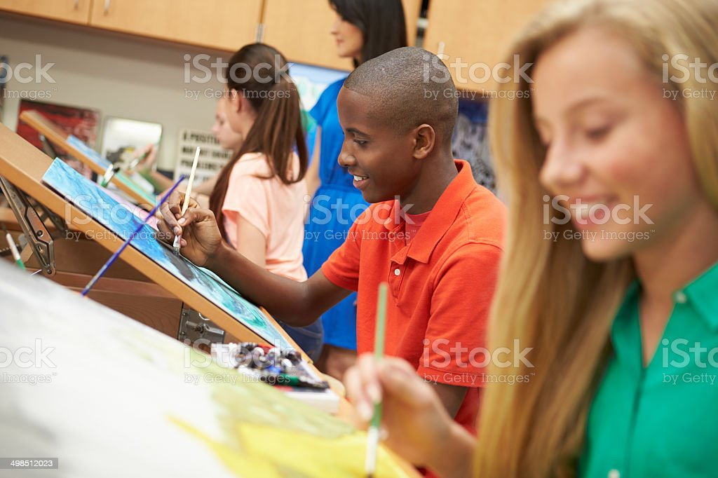 Male Pupil In High School Art Class stock photo