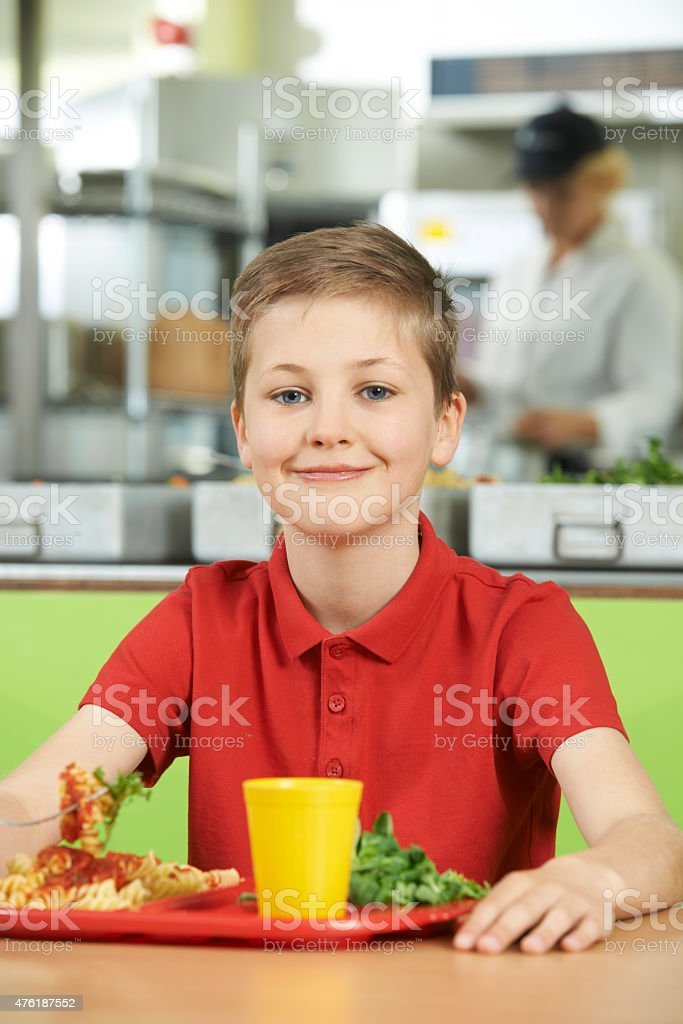 Male Pupil School Cafeteria Eating Healthy Lunch stock photo