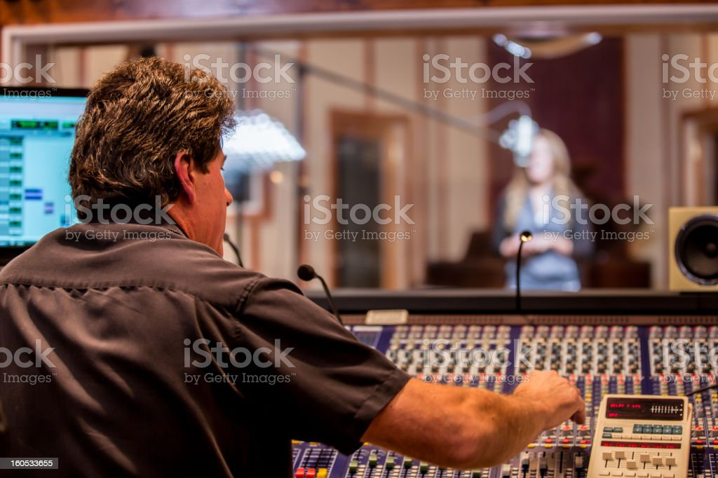 Male Recording Engineer and Artist in Studio stock photo