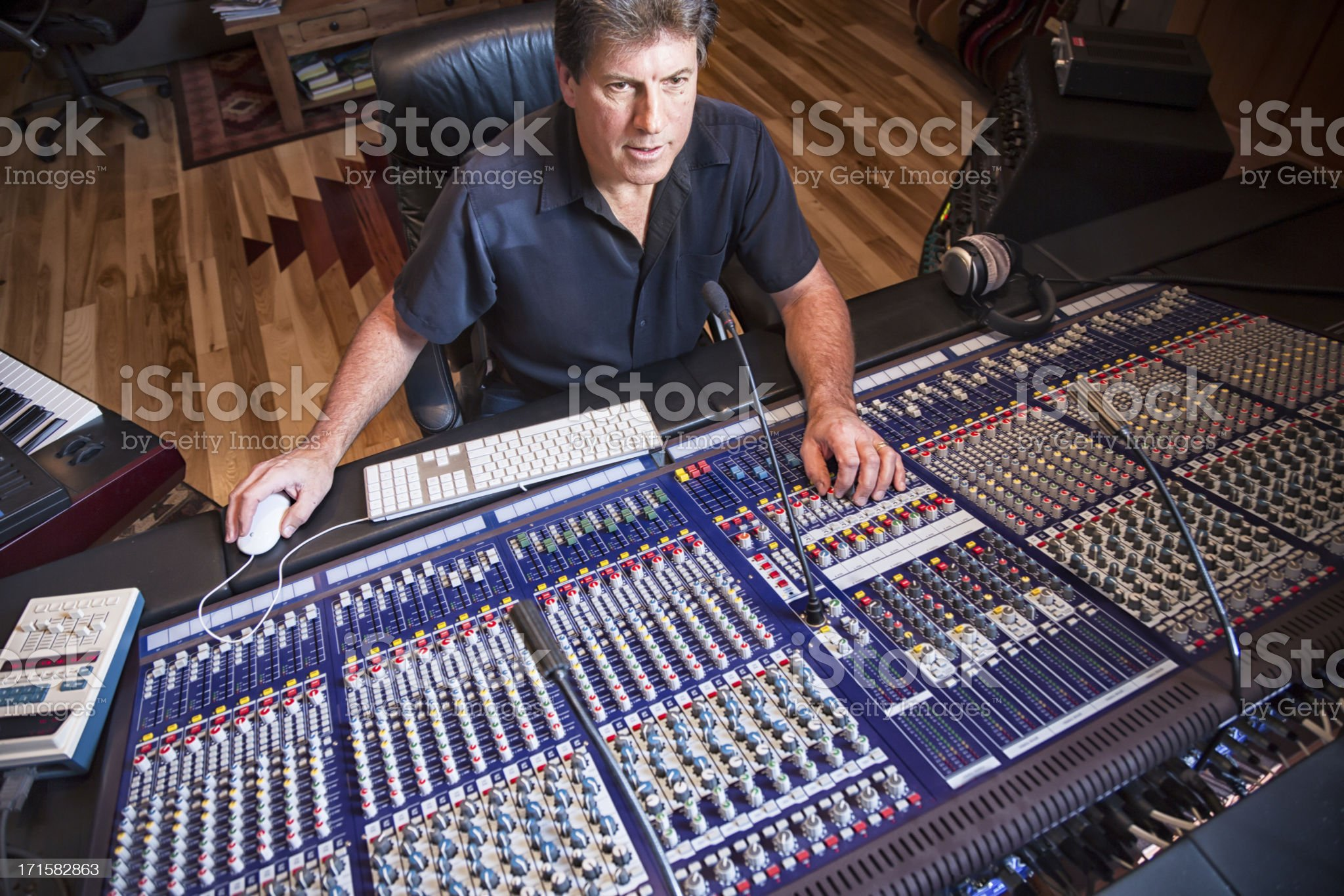 Male Recording Engineer and Artist in Studio royalty-free stock photo