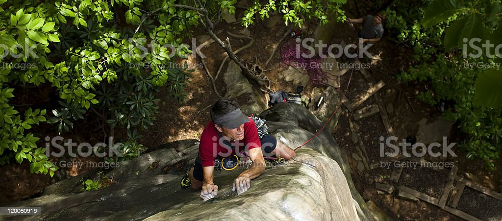 Male Rock Climber Ascending an Arete stock photo