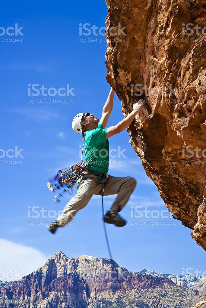 Male rock climber reaching for the summit. royalty-free stock photo