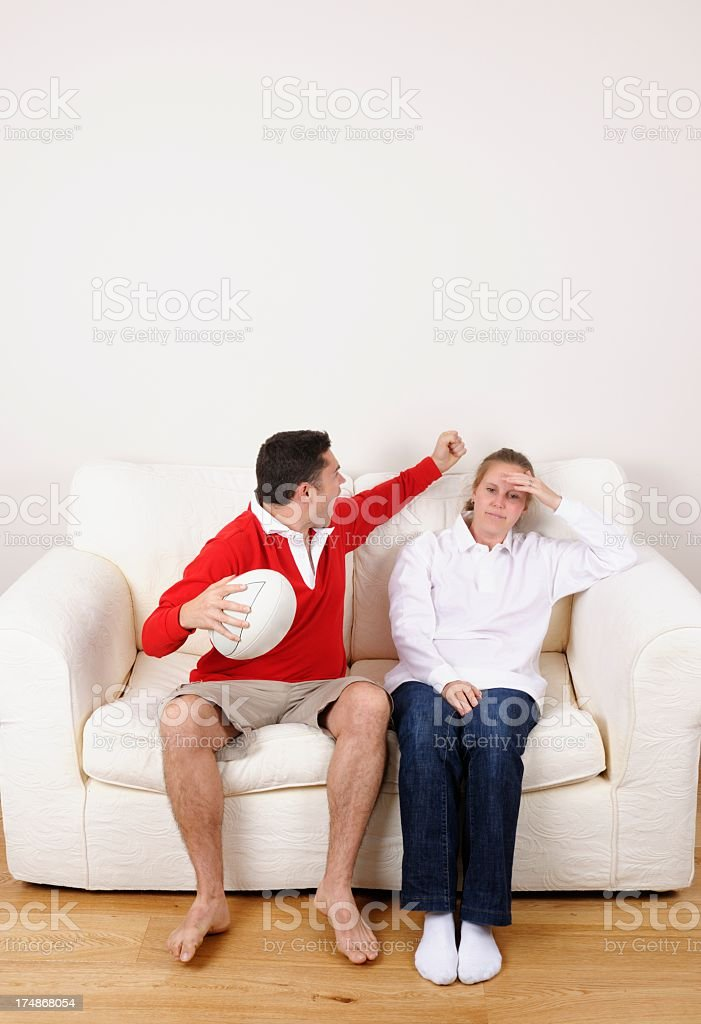 Male Rugby Fan Celebrates Victory While Female Counterpart Agonises stock photo