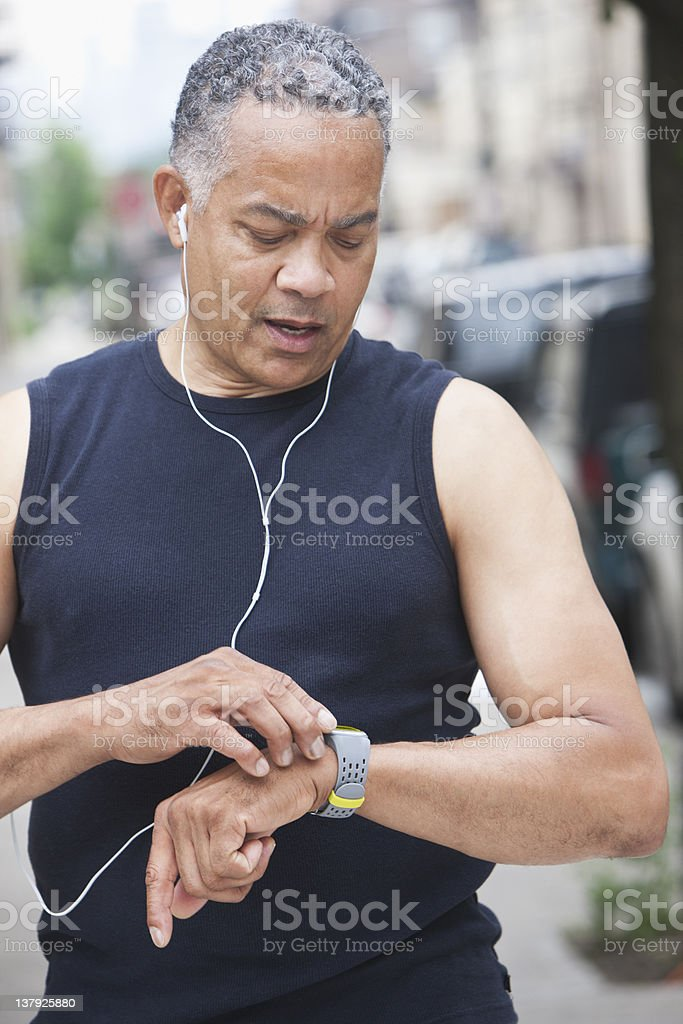 Male runner checking time stock photo