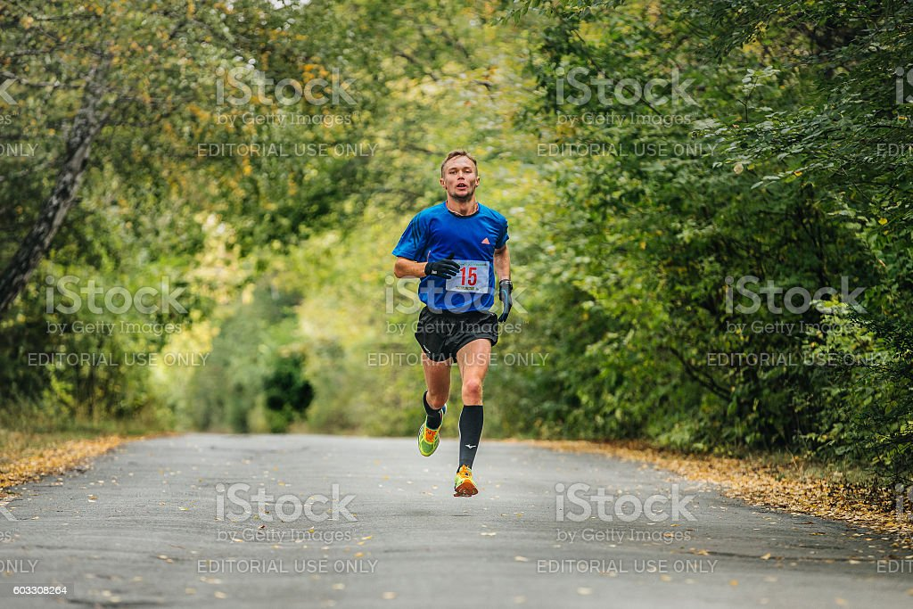 male runner leader of race running in autumn Park royalty-free 스톡 사진