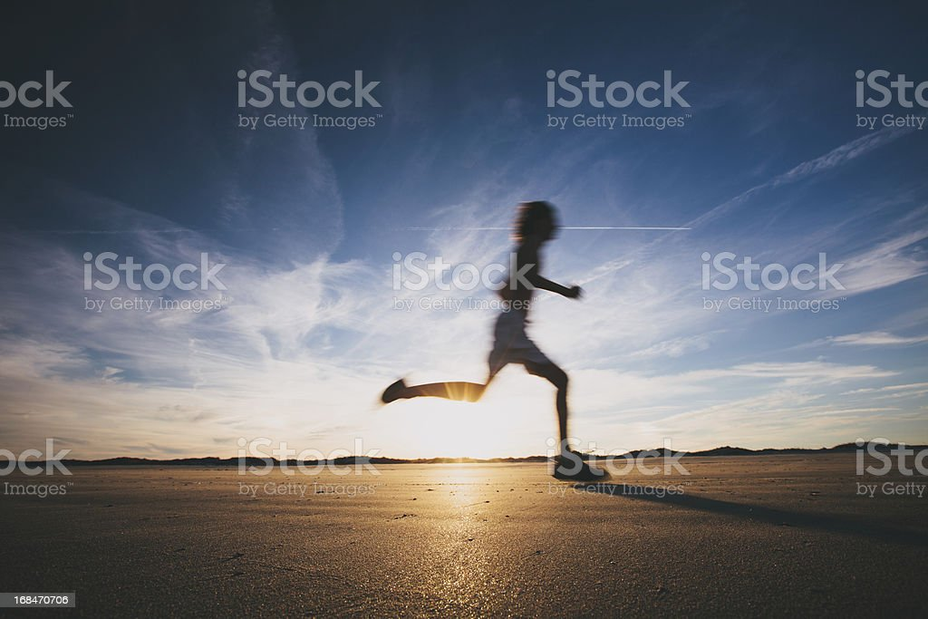 Male runner out for a training run at sunset royalty-free stock photo