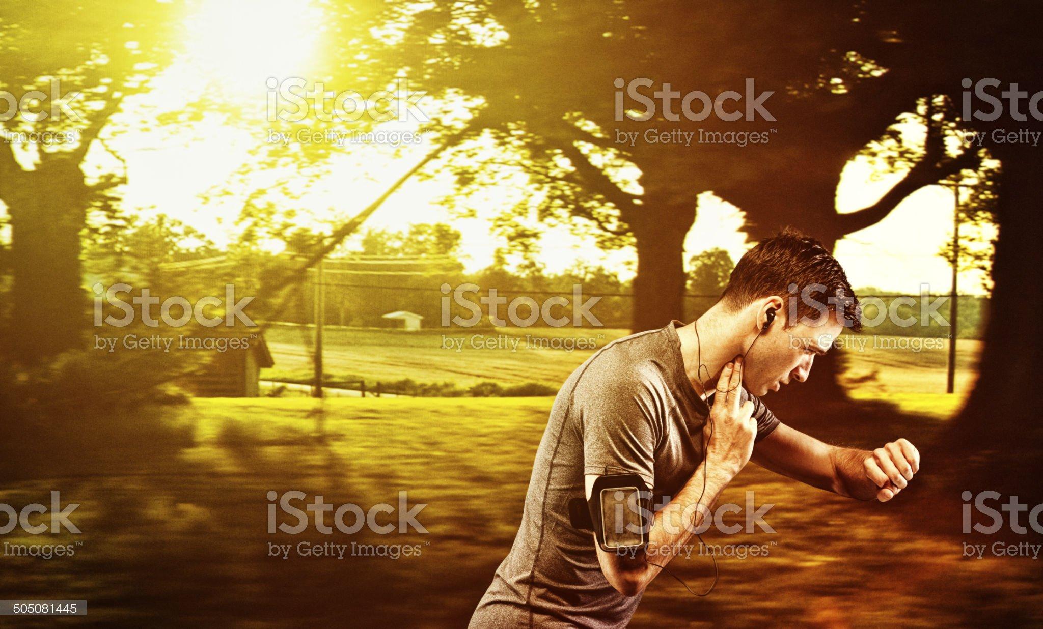 Male runner running in front of rural scene royalty-free stock photo