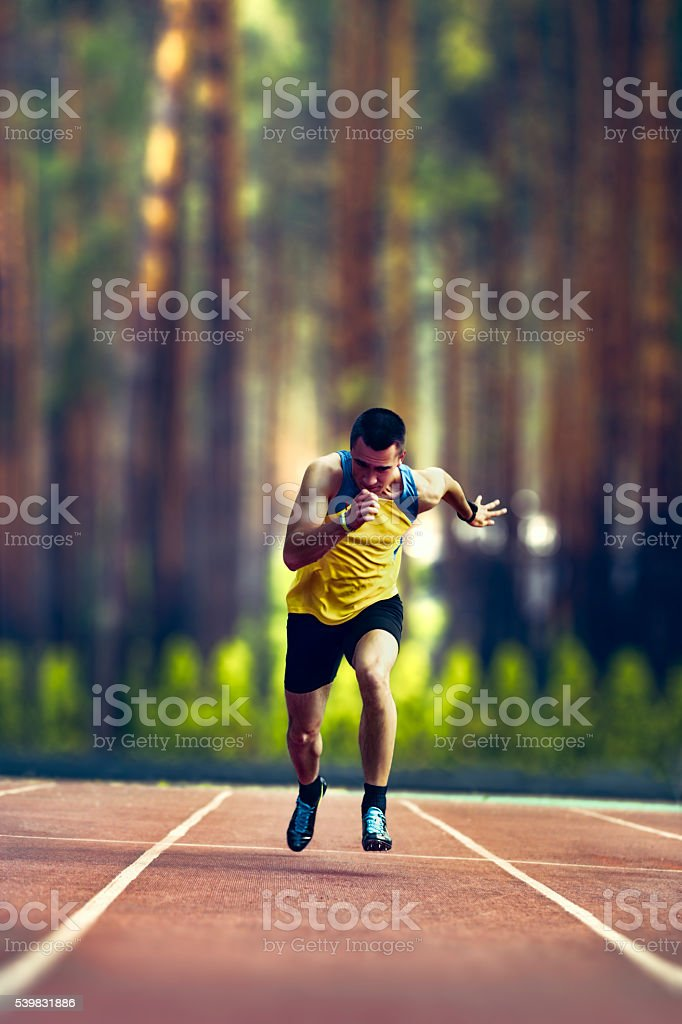 Male runner sprinting during outdoors training on nature. stock photo
