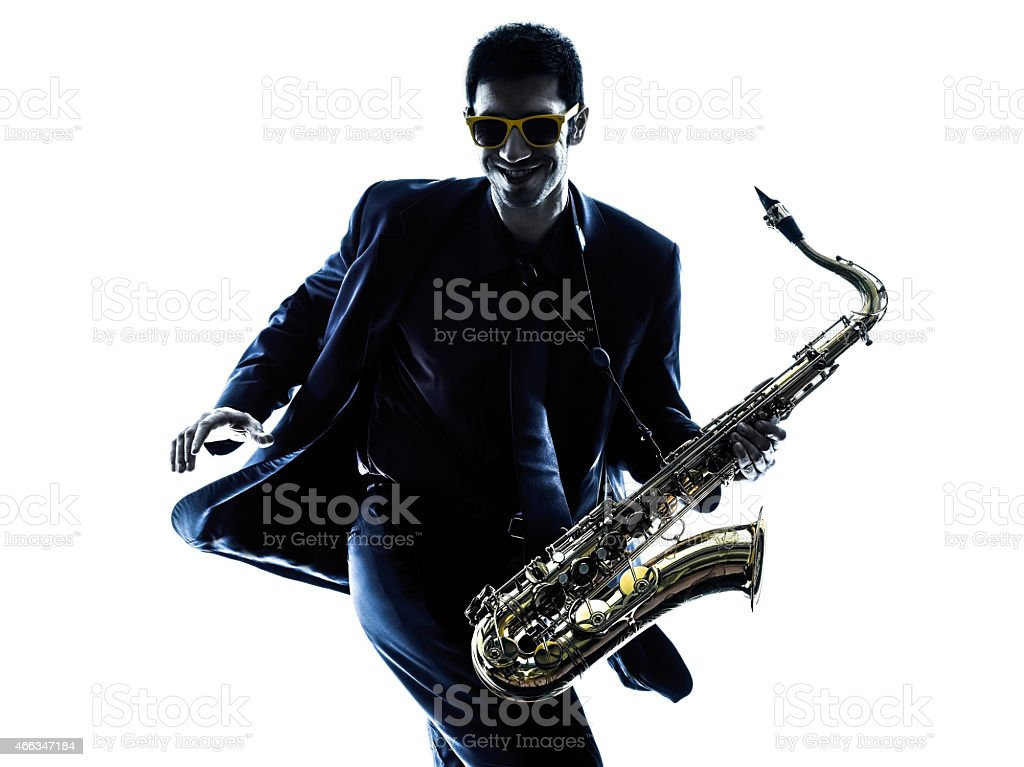 A male saxophonist wearing sunglasses and dancing stock photo