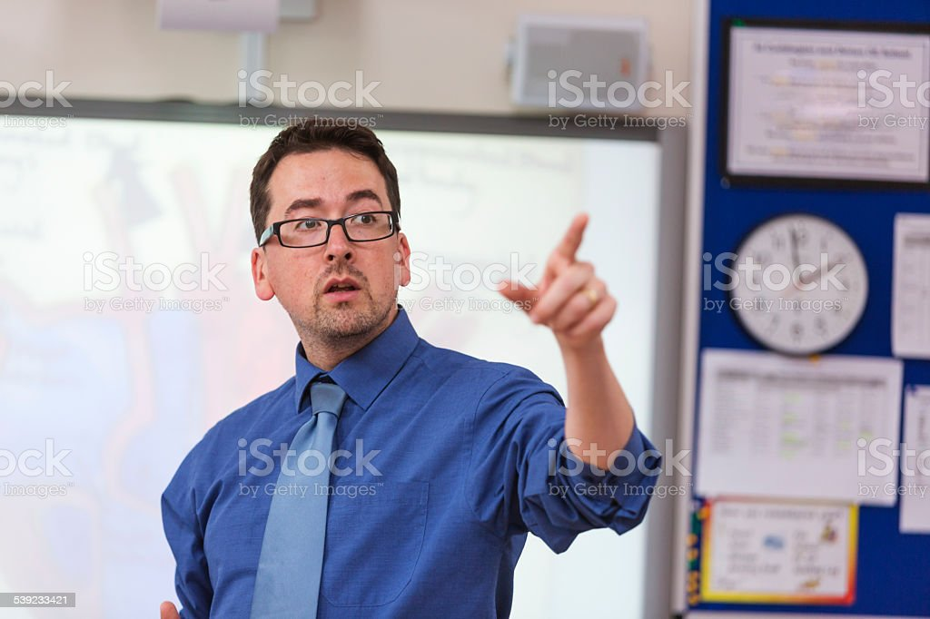 Male School Teacher Lecturing to Class stock photo