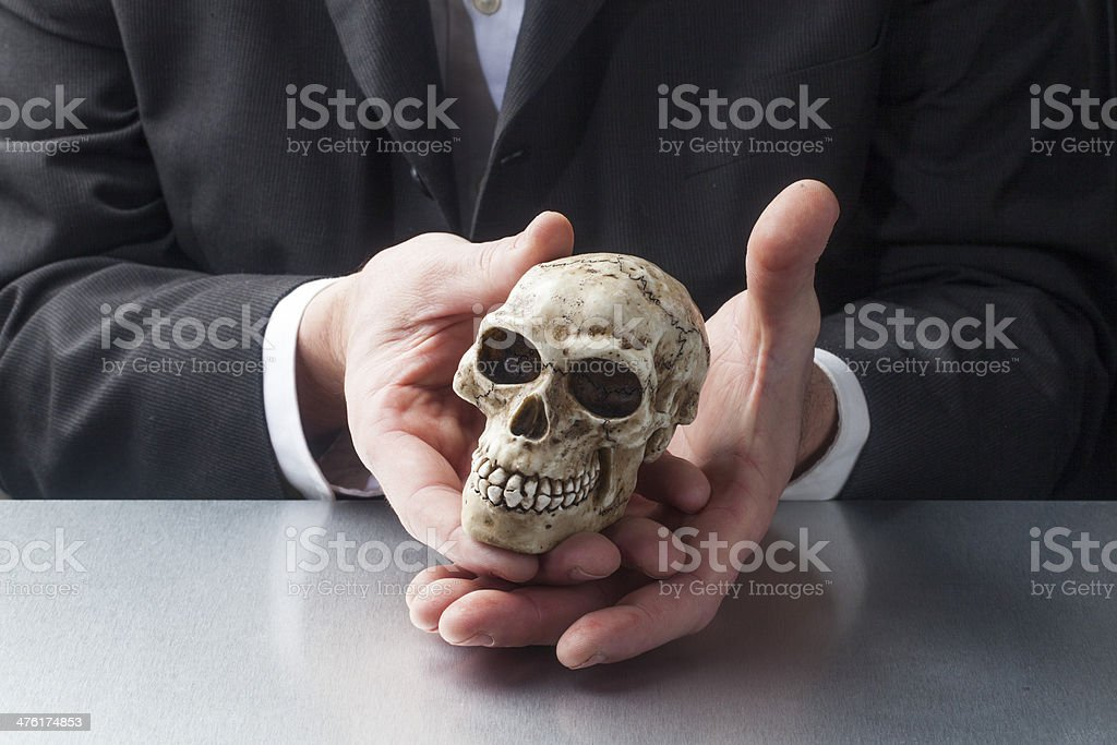 male scientist displaying a skull royalty-free stock photo
