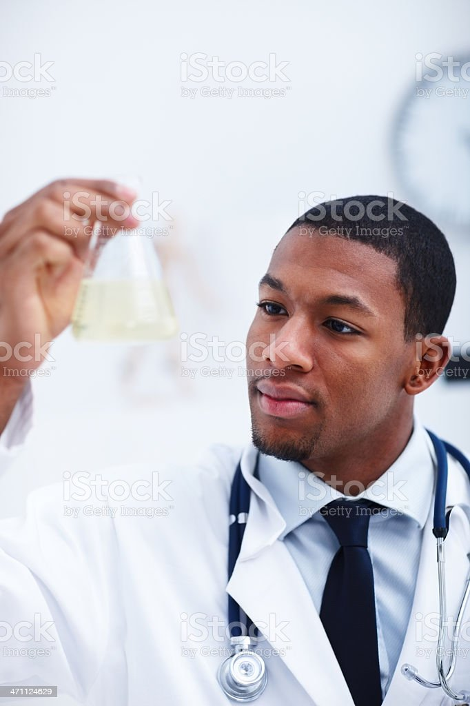 Male scientist holding flask and experimenting royalty-free stock photo