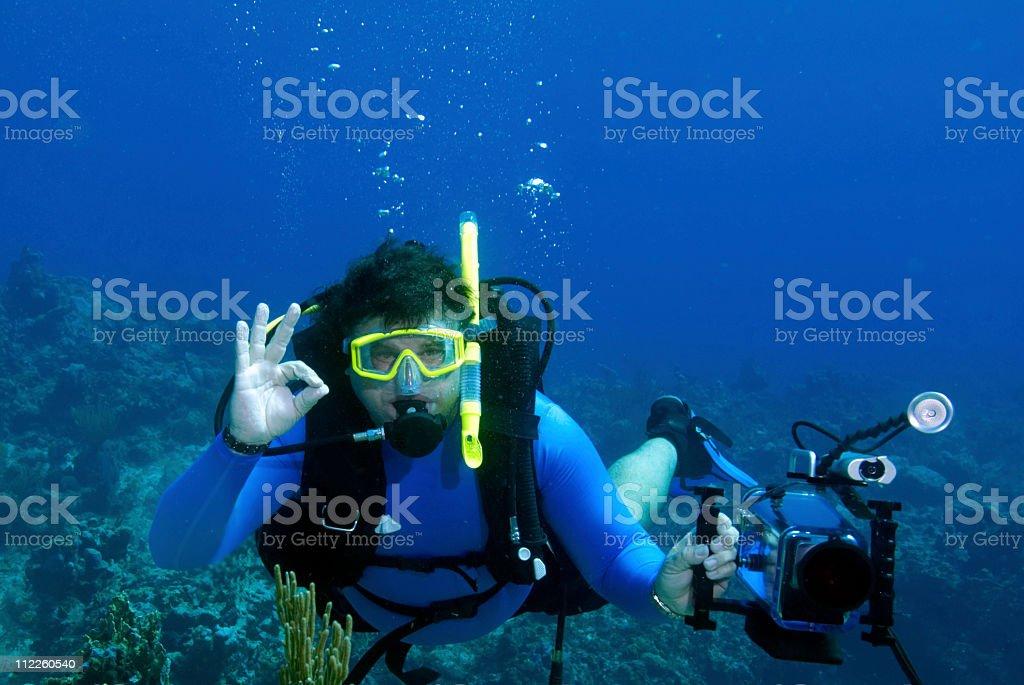Male Scuba Diver ok sign stock photo