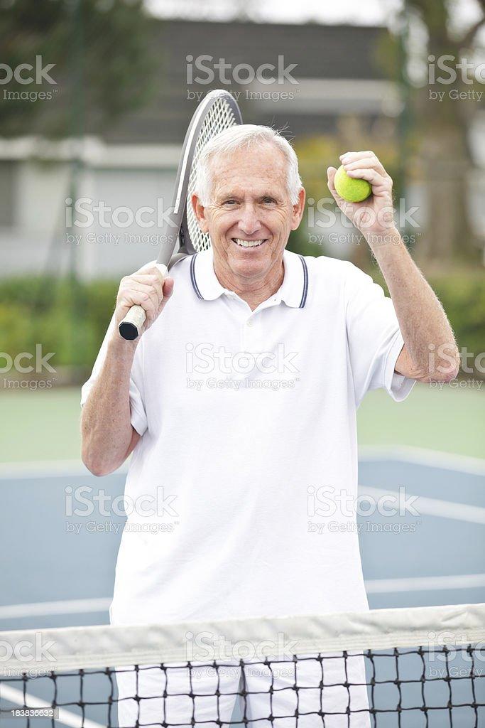 male senior celebrating his win in tennis royalty-free stock photo
