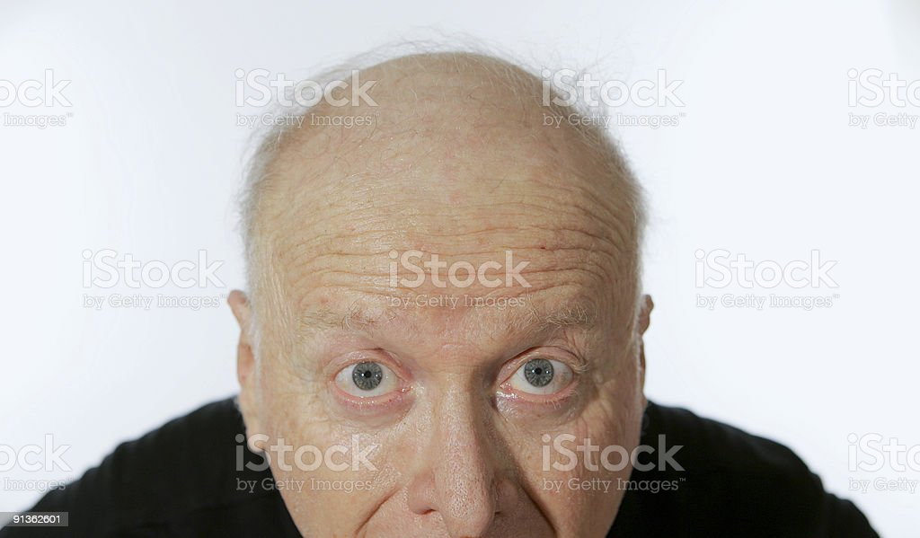Male senior citizen looks wide-eyed into camera royalty-free stock photo
