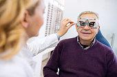 Male senior examine eyes