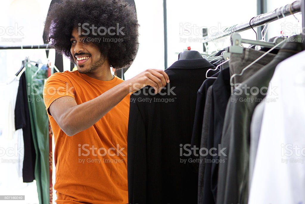 Male shopper looking for clothes stock photo