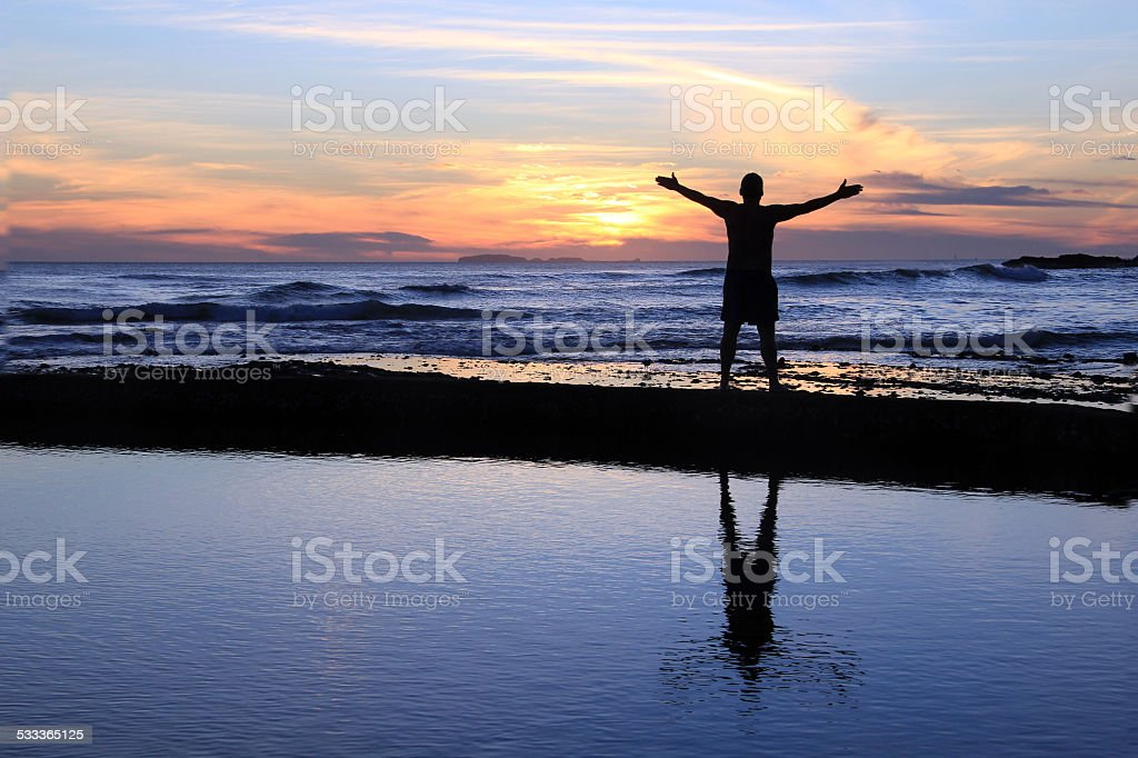 Male silhouette at sunset. stock photo
