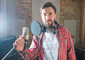 Male singer at a recording studio