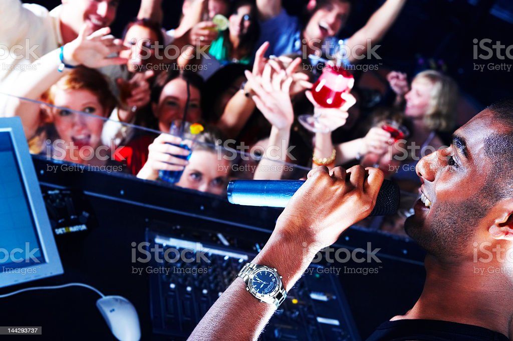 Male singer performing in front of crowd royalty-free stock photo