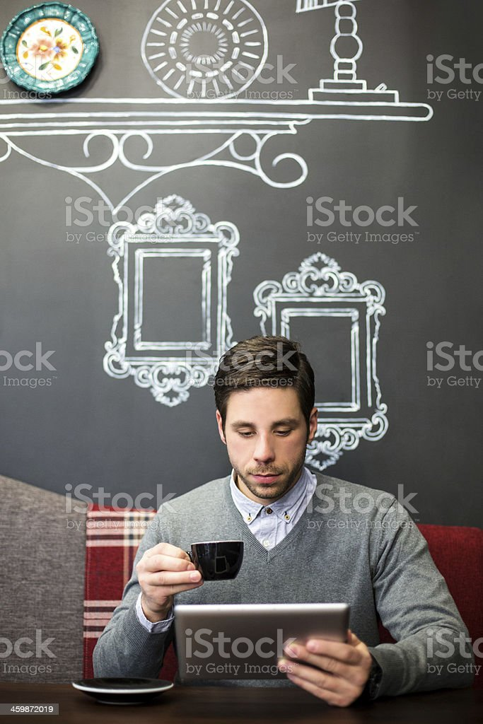 Male sitting in cafe and surfing net royalty-free stock photo