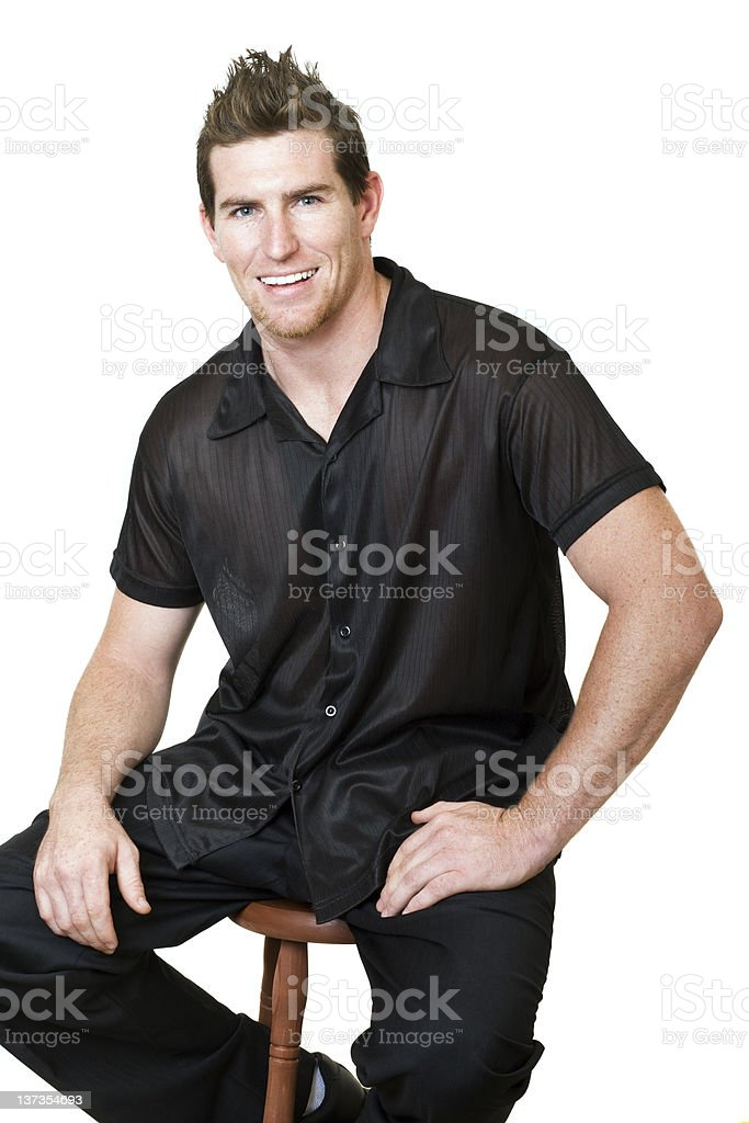 Male sitting on a stool royalty-free stock photo