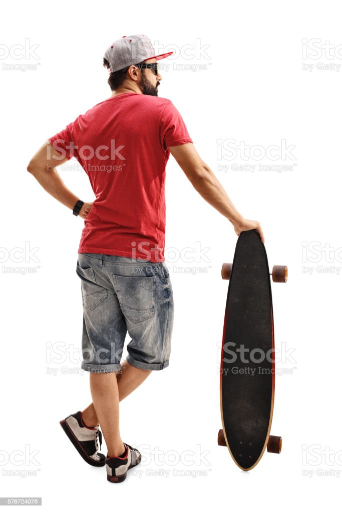 Male skater leaning on a longboard stock photo