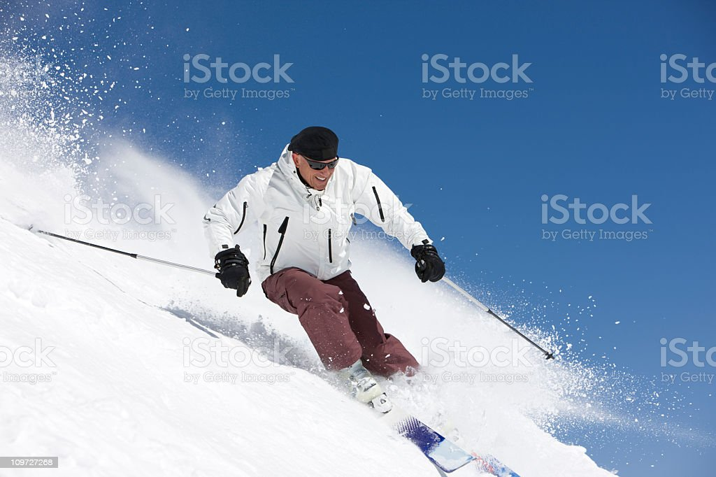 Male Skier Flying Down The Slopes royalty-free stock photo
