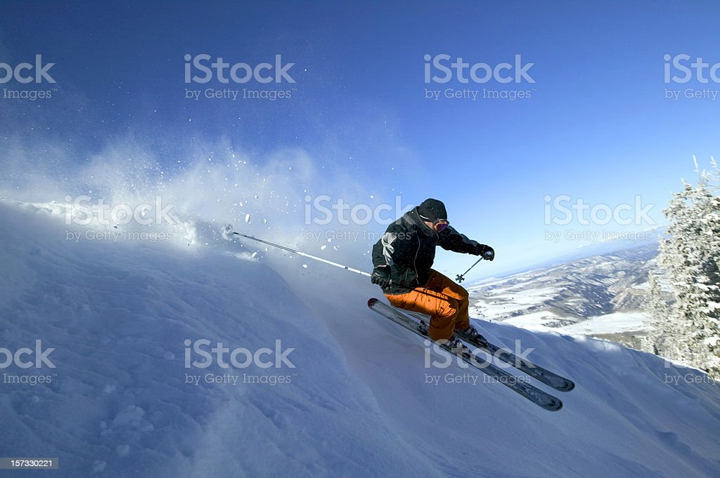 Male skier in fresh powder snow stock photo
