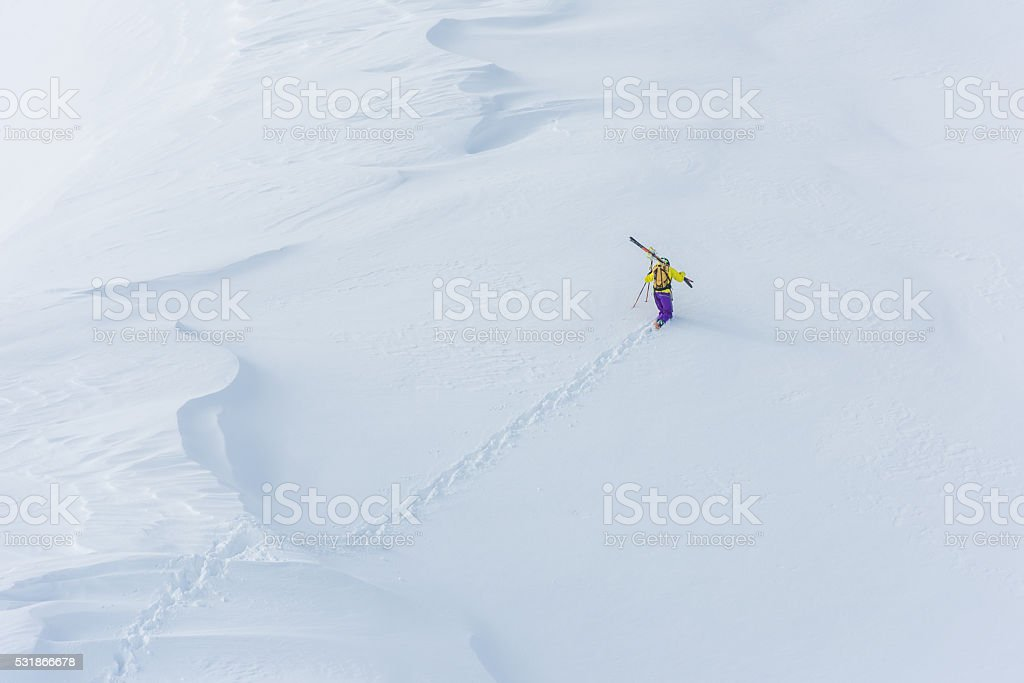 Male skier in snow stock photo