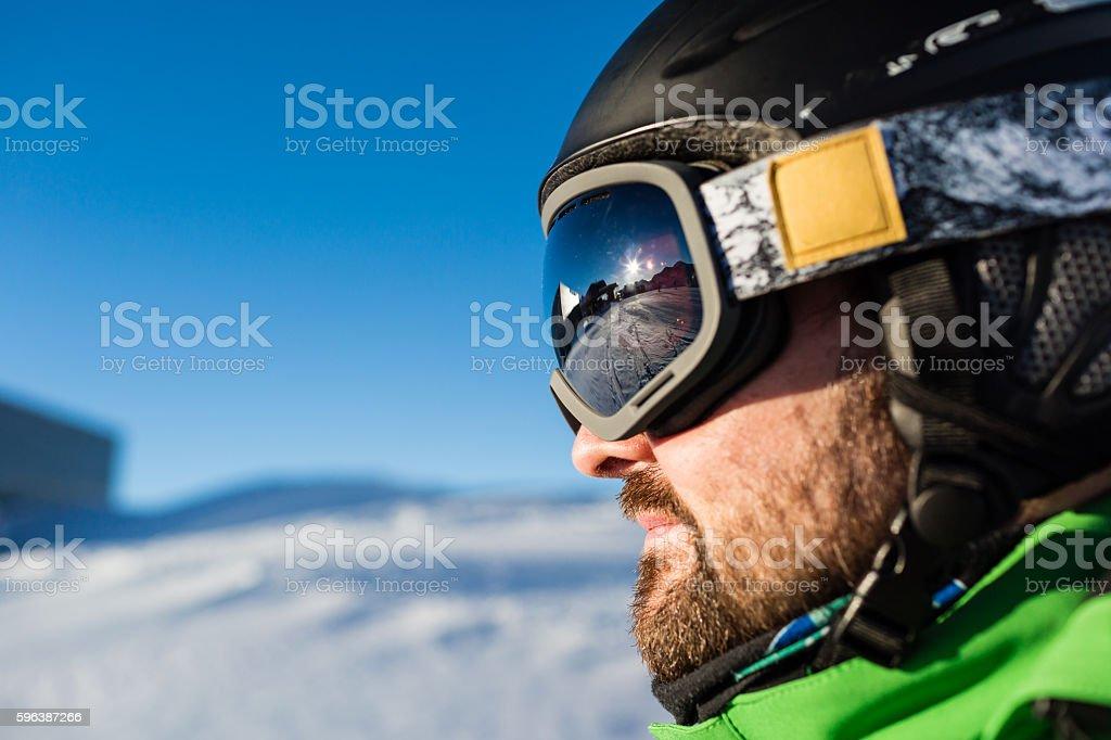 Male skier with large oversized ski goggles stock photo